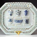 Mara Superior, Americana: A Collection of Blue Salt-glazed Stoneware 2016, porcelain, glaze, gold leaf, 15 x 19 x 2″.